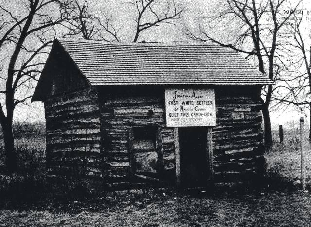 The original site of the home of the Jonathan Alder Cabin in 1973. The cemetery where Jonathan Alder is buried is to the left of the house and the old Alder Chapel, which was torn down a few years ago, stood to the right.