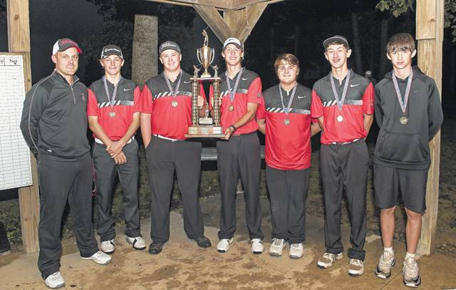 Members of the Jonathan Alder boys golf team pose with the championship trophy from the Madison County Tournament played Wednesday at Buck Ridge Golf Course. From left are: Coach Mitch Koester, Hayden Mitchell, Zach Otto, Giuseppe Petralla, Mychal McKelvey, Tyler Hilbert and Liam Thompson.