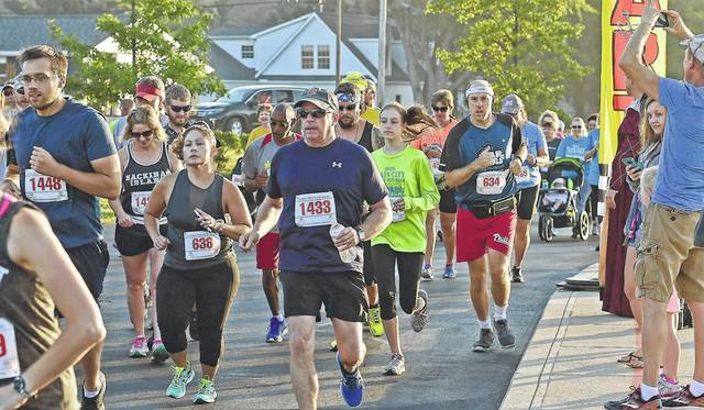 Racers make their way through the streets of Plain City during the 10th annual Plain City 4-mile Run/Walk Saturday, Sept. 23. Hundreds of runners/walkers participated in the event which took runners and walkers through the historic Uptown business district, Pastime Park and the surrounding neighborhoods.
