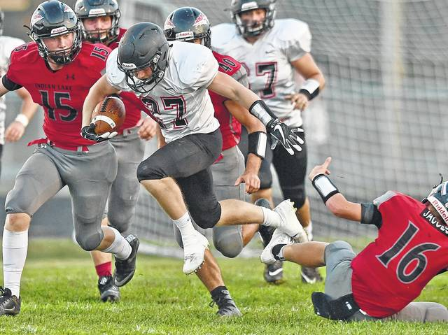 Jonathan Alder's Jamie Dye breaks tackles during the Pioneers 35-34 OT win at Indian Lake Friday, Sept. 22.