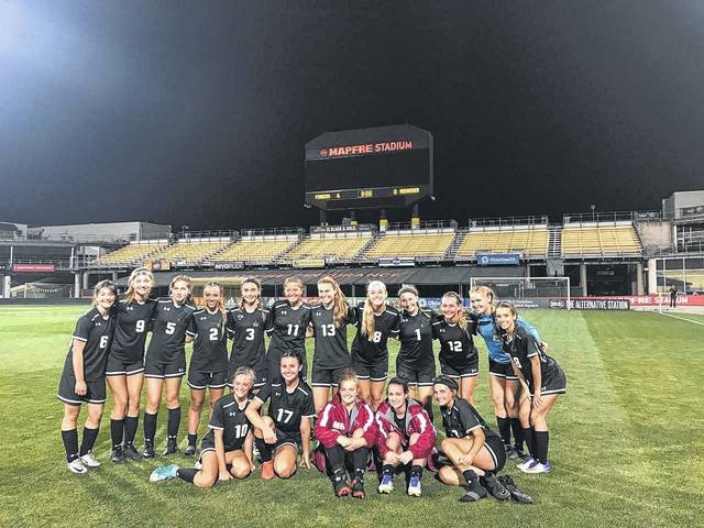 Members of the Jonathan Alder girls soccer team are all smiles after the Lady Pioneers defeated London 5-0 Saturday, Sept. 9 in a game played at Mapfre Stadium.