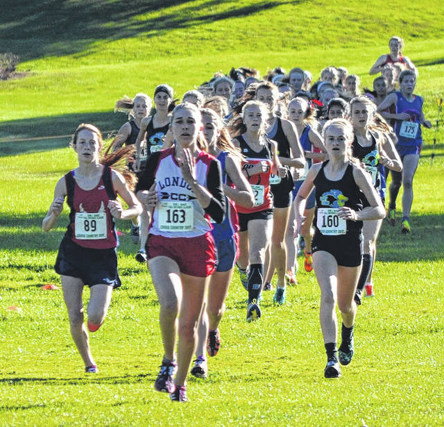 London High School&#8217;s Jordan Marco leads part of the pack during the girls varsity race in the Erin L. Nance Distance Classic, held Saturday at London Country Club.<span style=&quot;font-size: 12pt;&quot;>&nbsp;</span>