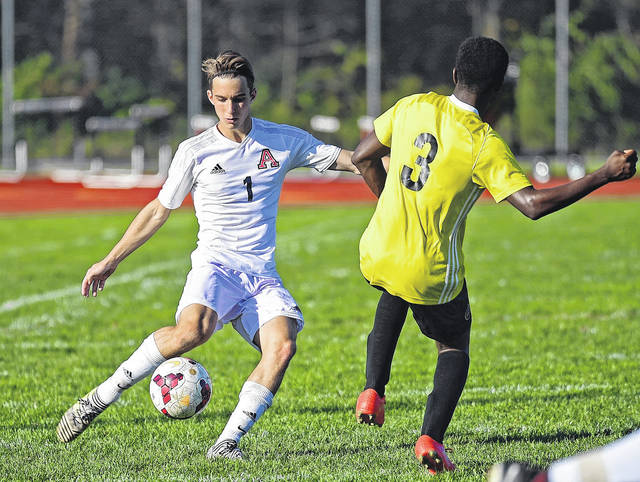 Jonathan Alder's Nathan Perkey makes a play on the ball during a game earlier this season. The Pioneers will play in their first-ever Division II district championship game Saturday against St. Francis DeSales.
