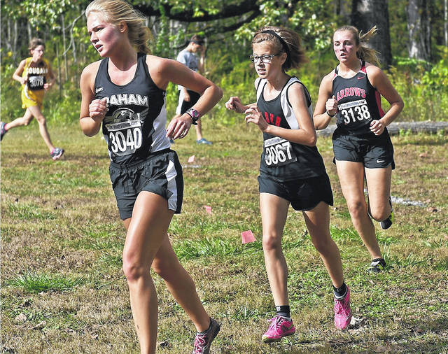Jonathan Alder's Annie Hirshberg, center, and her Lady Pioneers teammates will run in the Division II Regional meet Saturday, Oct. 28 at Pickerington High School North.