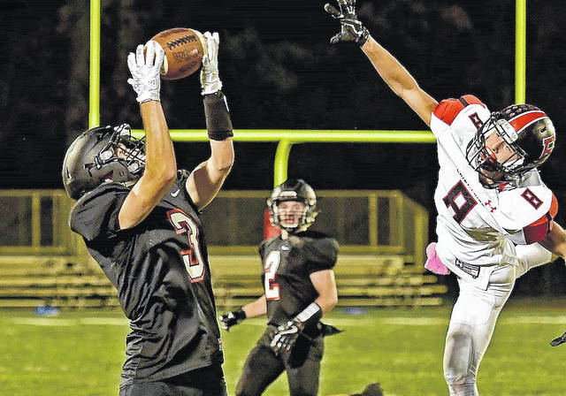 Jonathan Alder's Trevor Mitchell hauls in a pass during the Pioneers 19-6 loss to Bellefontaine Friday night, Oct. 6.