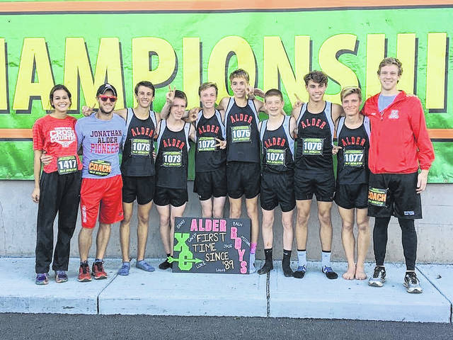 Members of the Jonathan Alder boys cross country team pose for a photo following the Pioneers 12th-place finish at the OHSAA state championship meet Saturday, Nov. 4 at National Trail Raceway in Hebron.
