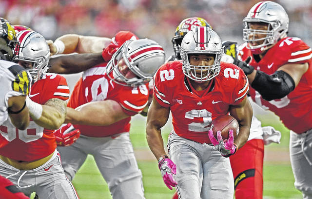 Ohio State's JK Dobbins races into the end zone during the Buckeyes game with Oklahoma earlier this season. OSU will host Michigan State Saturday at noon.