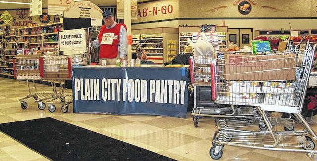 Lovejoy's Food Market in Plain City held a food drive for the Plain City Food Pantry on Saturday, Nov. 18. Standing is Tom Burkhart of the Burkhart Ministries out of Marysville greeting all those who came in to the store. More than 3,500 assorted cans and boxes of food were collected by Lovejoy's Food Market for the Plain City Food Pantry. Plain City Food Pantry thanks everybody for their contribution and support.