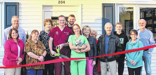 Family, friends and staff joined Dr. Daniel Lynn for a recent ribbon cutting ceremony for the Plain City Animal Hospital's new addition. The expansion project features a new entrance, spacious lobby and additional exam rooms and will enable this growing veterinary practice to better serve clients from Plain City and surrounding communities.