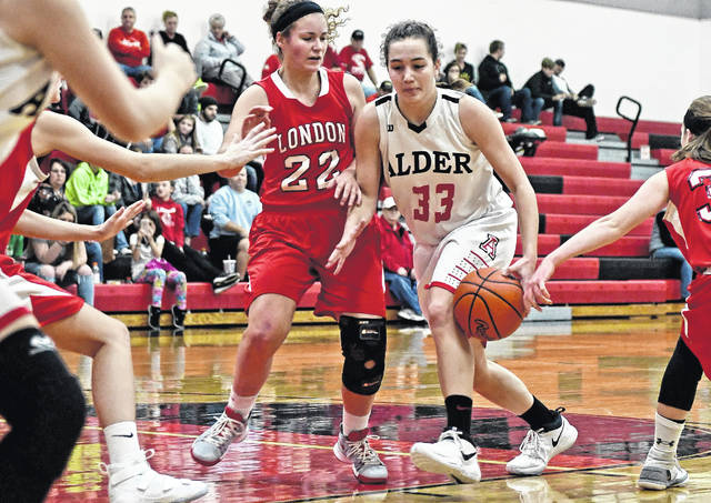 Jonathan Alder's Emily Davis attacks the London defense during a game earlier this season. The Lady Pioneers defeated visiting Bellefontaine 65-21 Wednesday night.