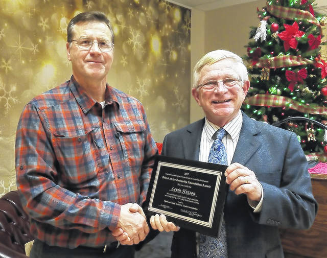 Michael Boerger, right, President of the Madison County Township Association, presents Levin Hutson with the Friend of the Townships Award.