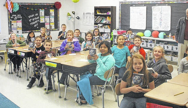 Third graders from Monroe Elementary School recently received their own dictionaries from the Marysville Elks.