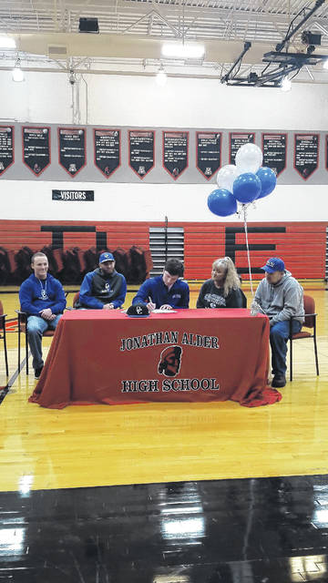 Austin Hurley, a Jonathan Alder senior, recently signed a commitment letter to play baseball at Ohio Christian University. He was joined at the signing ceremony at the school by from left: Ohio Christian University assistant coach Brian Daria, Ohio Christian University head coach Michael Blevins, Austin Hurley, Diedra Hurley (mom) and Jerry Hurley (dad).