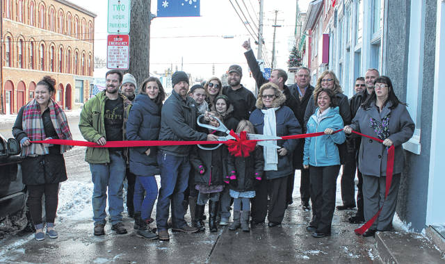 Plain City village officials met with the operators of Tavern 161 Tuesday for a ribbon-cutting ceremony. The restaurant and bar, serving a full menu of southern-inspired dishes and offering live music performances, will have its grand opening Jan. 23.