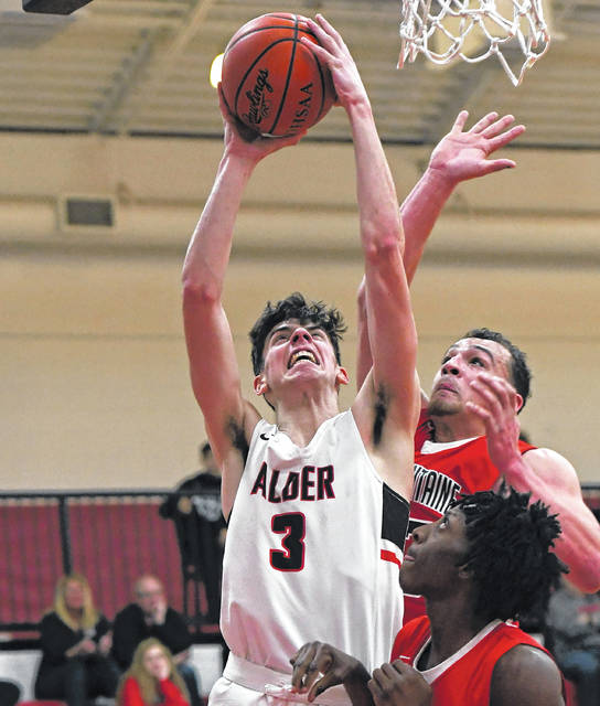 Jonathan Alder's Henry Walker (3) goes up for a shot during the Pioneers win over visiting Bellefontaine Tuesday.