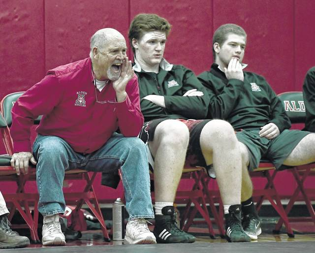 Jonathan Alder wrestling coach Ron Thomas Sr., left, will lead his team into a tournament this weekend named in his honor. Wrestling action starts at 10 a.m. Saturday.