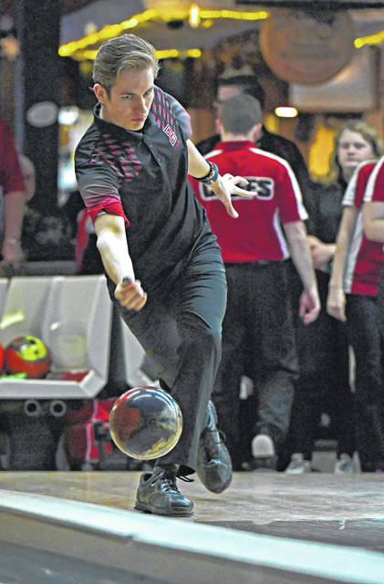 Jonathan Alder's Andrew Clark fires at pins during the Pioneers recent loss to Bellefontaine.