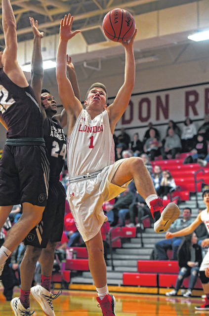 London's Josh Handley goes up for a shot during the Red Raiders loss to visiting Columbus Academy Saturday, Jan. 20.