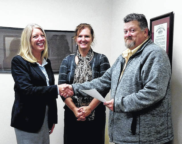 The Madison County Board of Developmental Disabilities welcomed new Board Member Khrista King, left, Thursday, Jan. 18. She was installed by Madison County Commissioner David Hunter, right, as Madison County Board of Developmental Disabilities Superintendent Susan Thompson looks on.