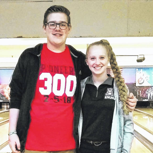 Jonathan Alder bowlers Jacob Schrock, left, and Rena Kirts led the Pioneers to a sweep of both the girls and boys Division II Sectional Tournament championships held at HP Lanes in Columbus.