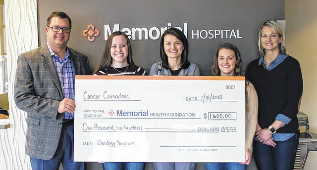 Participating in the check presentation to Memorial Health for $1,600 were from left: Chip Hubbs, Memorial Health President/CEO; Shannon Conroy, Fairbanks student; Amy Higinbotham, Director of Specialty Care; Shaune O'Connors, Marysville student; and Laura Falk, Fairbanks Student Advisor.