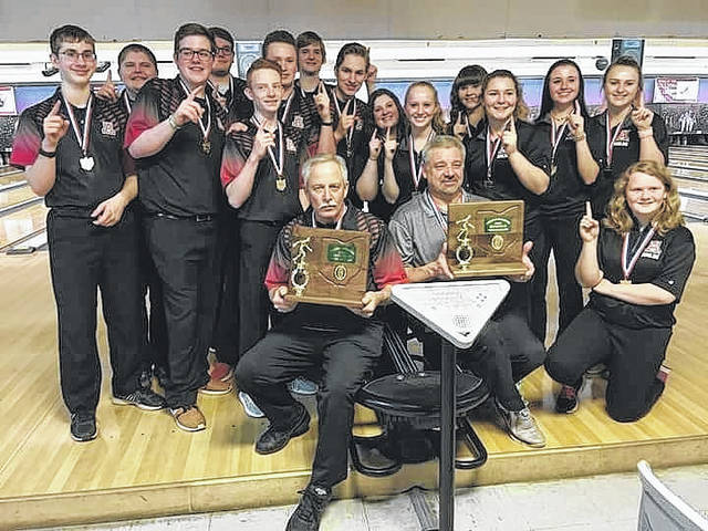 Members of both the Jonathan Alder boys and girls bowling teams pose with Central District championship trophies following a Pioneers sweep of the tournament Thursday at HP Lanes in Columbus.