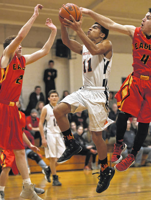 Shekinah Christian's Eli McKee drives in for a basket during a Flames win earlier this season.