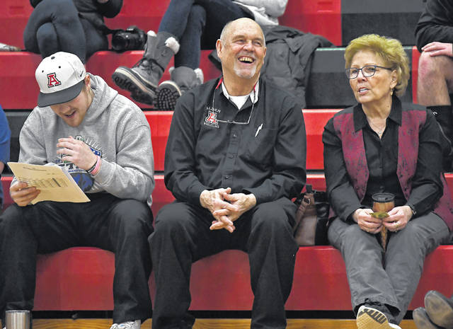 Jonathan Alder wrestling coach Ron Thomas Sr., center, will lead his Pioneers into this upcoming weekend's D-II sectional tournament.