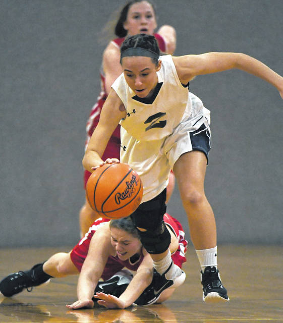 Shekinah Christian's Hannah Headlee keeps control of the ball during the Flames win over Delaware Christian last week.