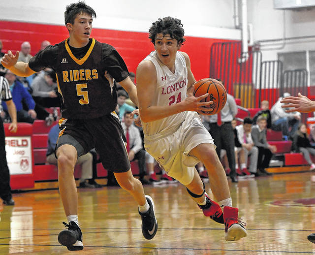 London's Isaiah Hatem, right, drives to the basket against West Jefferson's Joe Thompson during a game last week.