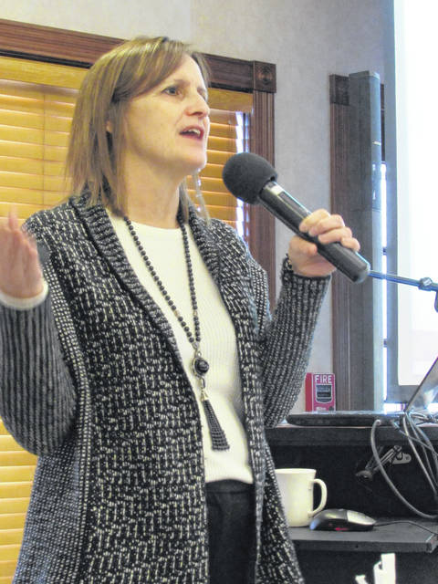 Peggy Kirk, Assistant Professor, Ohio State Agricultural and Resource Law Program, speaking about legal trends, Friday, at the Farmer's Breakfast in Plain City.