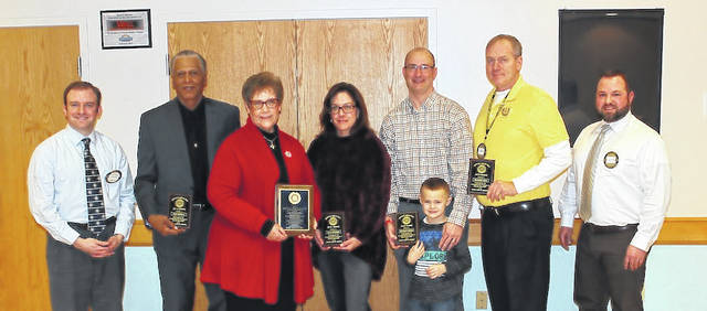 """The London Rotary Club bestowed the awards for their annual """"Service Above Self Award"""" London Rotary Club's annual awards luncheon on Thursday. From left are: Rotary vice president Brendan Shea, Dale McNeal, Sue McClelland, Lisa Jackman, Jason Noble and Jaxon Noble, Marshall Geib, and Nick Adkins."""