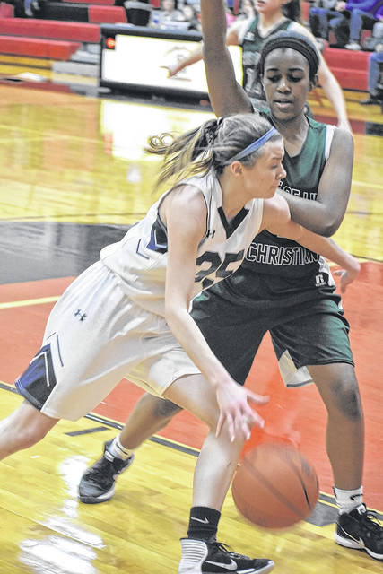Shekinah Christian's Natalie Headings drives past a Tree of Life defender during the Flames tournament opener last week. The No. 3 seed however was unable to knock off No. 4 Danville Saturday, Feb. 24 and had its season come to an end.