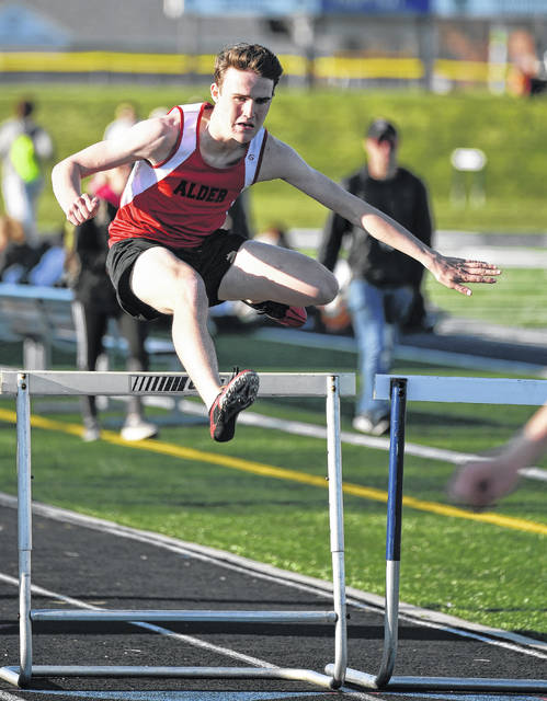 Jonathan Alder's Clayton Boggs clears a hurdle during the Bobcat Booster Invitational held Friday, April 20 at Grandview High School.