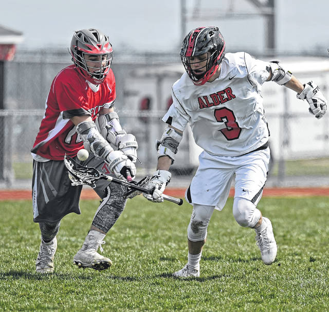 Jonathan Alder's Trevor Mitchell, right, fights for possession of the ball during a win over Johnstown-Monroe.