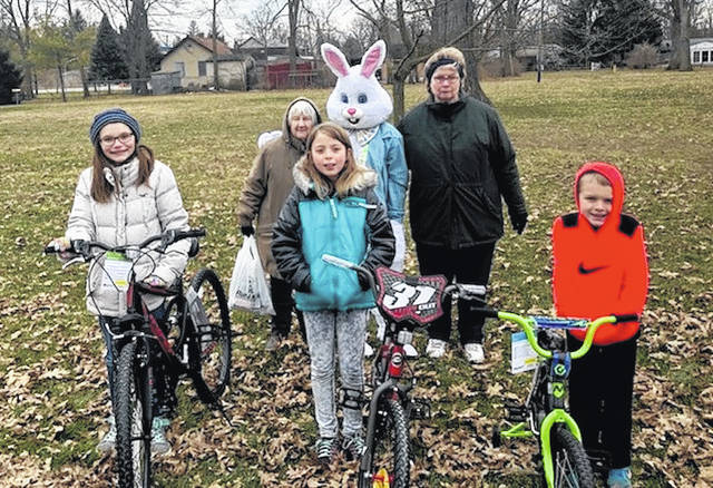 The Easter Egg Hunt at Pastime Park on Saturday, March 24 was hosted by the Plain City VFW and VFW Auxiliary Darby Post 3268 in Plain City. Local businesses and individuals all donate to make the event possible. Over 5,000 eggs are placed, and dozens of prizes are given away, including bikes. Yoder's True Value Hardware donates the bikes each year. Winners of the bikes are front from left: Jaiden Archer, Emma Vigar and Owen Hanna. Also at the Easter Egg Hunt are back from left: Carolyn Williamson, the Easter bunny and Donna Burchett, organizers and members of the VFW Auxiliary.