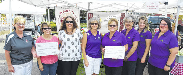 Uptown Plain City Organization (UPCO) awarded the second year Business Improvement Grant (BIG) to Mainstreet Treasures and Rummell-Brill Insurance. From left are: Linda Peters and Kerri Ferguson of Mainstreet Treasures, Shannon Pine and Julie Weaver of UPCO, Jenny Brill, Kathy Whitley, Rose Sherwood, and Anna Francis of Rummell-Brill Insurance.