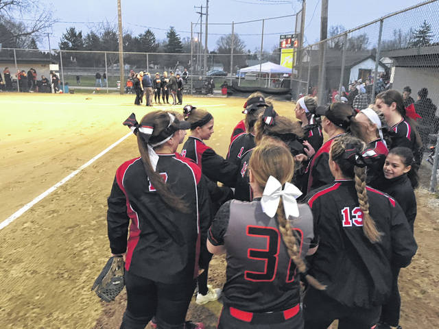 Jonathan Alder huddles up prior to its night game at Pastime Park Saturday, April 14 against North Union.