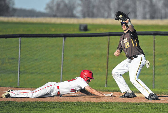 West Jefferson's Jordan South hauls in a throw at first base during the Roughriders recent win over host Fairbanks.