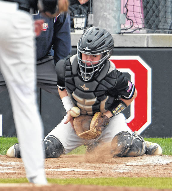 Jonathan Alder's Evan Martin blocks a pitch during the Pioneers home loss to Hilliard Bradley Saturday.