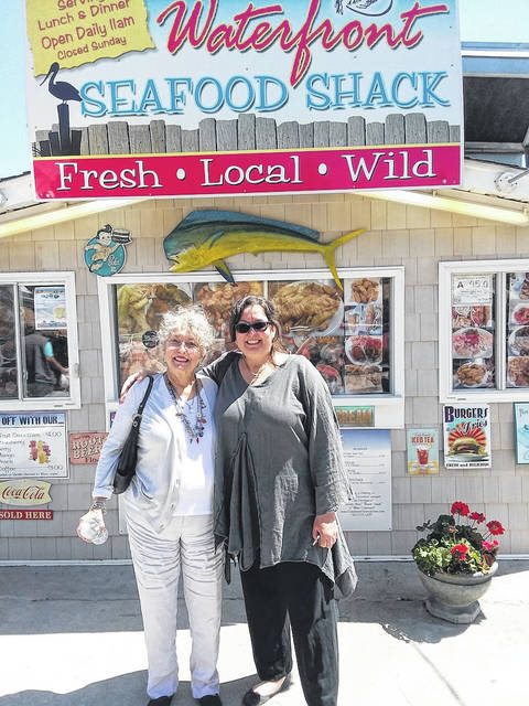 Linda Conway Eriksson, left, and her daughter Heather Lauer, stand in front of the The Seafood Shack in Calabash, North Carolina.