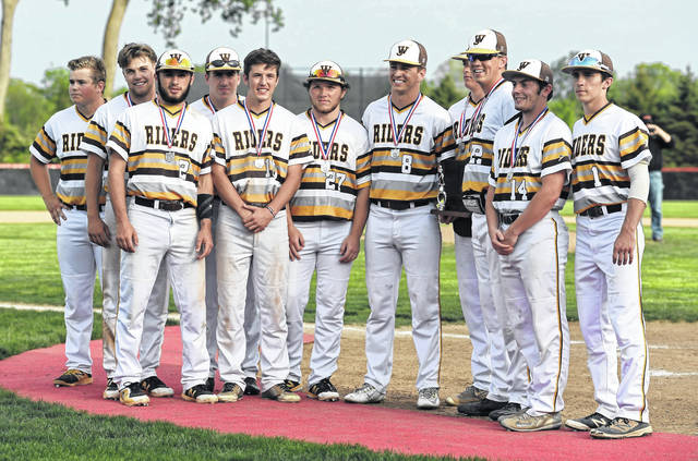 Seniors on the West Jefferson baseball team accept the school's Division III district runner-up trophy Thursday.