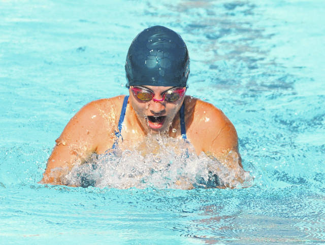 Madison County Marlins swimmer Emily Bennett competes in an event during a meet against the Plain City Sharks and Life Time Swim Ohio.