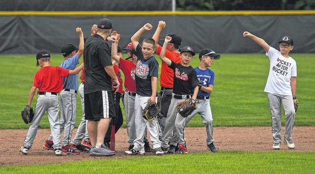 Baseball players celebrate during a drill Thursday.