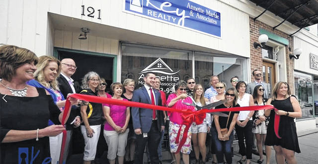 Plain City's downtown business owners gained a new neighbor recently with the grand opening of Annette Marble and Associates with Key Realty. This office, located at 121 W. Main St. right next to The Plain City Historical Society, is the new home to Key Realty's Annette Marble and her team of realtors. Community members, local business owners, and the State's Attorney's Office came out to celebrate and support the opening of this new local business on Thursday, May 31, at the ribbon cutting ceremony.